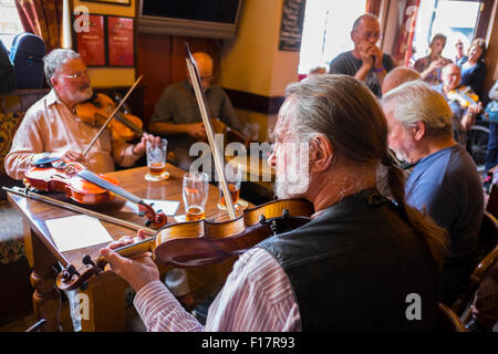 Folk musicians having an impromptu session in the Wheatsheaf pub during Shrewsbury Folk Festival, Shropshire, England, - Stock Photo