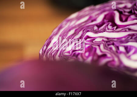 Fresh red cabbage cut in half to reveal a beautiful purple and white texture throughout - Stock Photo
