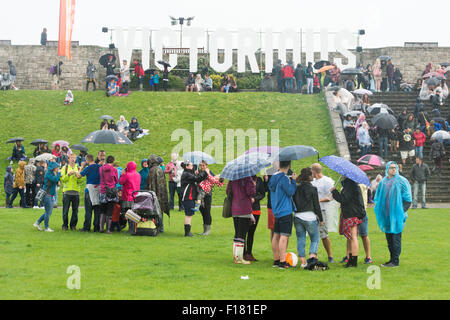 Portsmouth, UK. 29th August 2015. Victorious Festival - Saturday. Braving the rain at the Victorious Festival. Credit: - Stock Photo
