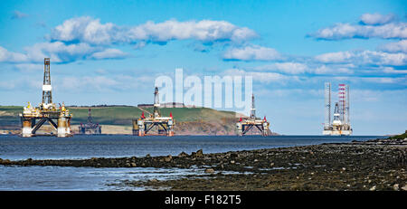 Oil drilling rigs anchored in the Cromarty Firth at the Black Isle Highland Scotland - Stock Photo