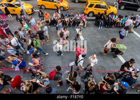 New York,, NY 29 August 2015 Tourists on Seventh Avenue in Times Square. New York City Mayor Bill de Blasio has - Stock Photo