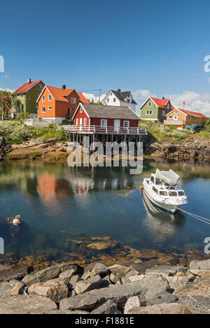Fishing village Henningsvaer in Lofoten islands, Norway with typical colorful wooden buildings - Stock Photo
