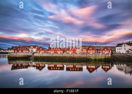 Sunset over harbor houses in Svolvaer. Svolvaer is located  in Nordland County on the island of Austvagoya in Lofoten, - Stock Photo
