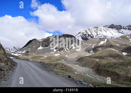 Rohtang Pass road Himalayas Mountains in Manali to Leh Ladakh highway Kullu Valley and Spiti Valleys of Himachal - Stock Photo
