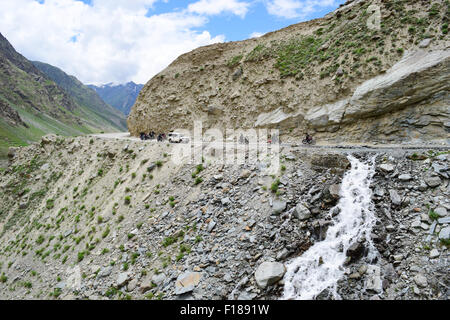 Dangerous kashmir Road trip in India at high altitude himalayas mountains passes motorbikes and jeep crossing landslide - Stock Photo