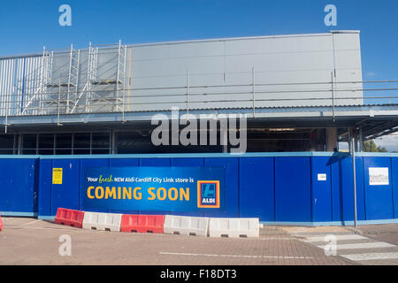 New Aldi opening soon sign at construction site City Link retail park Cardiff Wales UK - Stock Photo