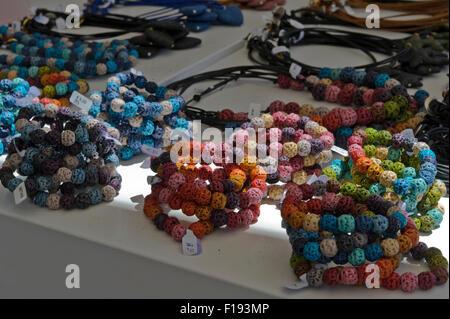 Colourful ladies bracelet made of beads on sale, Santorini, Greece. - Stock Photo