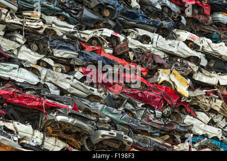 Capsized barge with crushed automobiles in Gorge Waterway-Victoria, British Columbia, Canada. - Stock Photo
