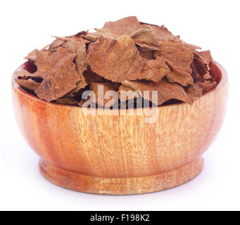 Dry tobacco leaves in a wooden bowl - Stock Photo
