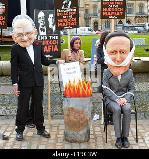 Activists from campaign group Avaaz wearing masks protest  the influence of the Murdoch family on British media. - Stock Photo