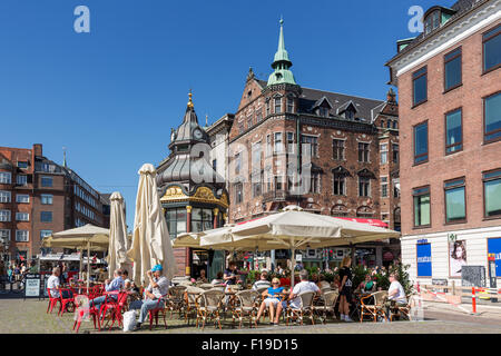 People sitting at a cafe in Nytorv (New Square), Copenhagen, Denmark - Stock Photo