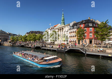Tour boat with tourists in Copenhagen Canal, Copenhagen, Denmark - Stock Photo