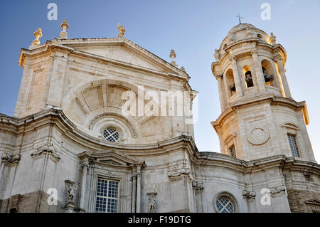 Front view at sunset of the Cadiz Catedral de la Santa Cruz with the belfry (Cadiz, Andalusia, Spain) - Stock Photo