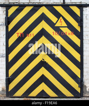 old door with yellow and black stripe - Stock Photo