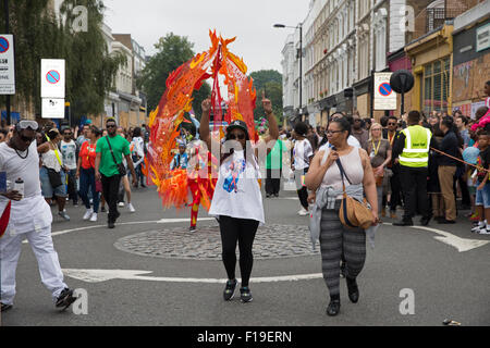 Notting Hill,UK,30th August 2015,Partygoers at the Notting Hill carnival childrens parad Credit: Keith Larby/Alamy - Stock Photo