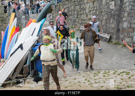 Mousehole, Cornwall, UK. 29th August 2015. The annual boat punt race where competitors have to race to the pub drink - Stock Photo