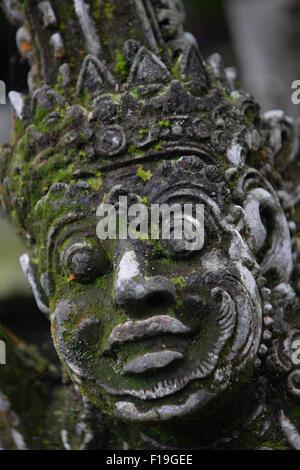 px0081-D. moss covered statue at Pura Luhur Batukau. Bali, Indonesia. Photo Copyright © Brandon Cole. All rights - Stock Photo