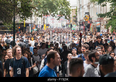 London, UK, 30th August 2015. Londoners enjoy the Notting Hill Carnival, Europe's largest street festival with its - Stock Photo