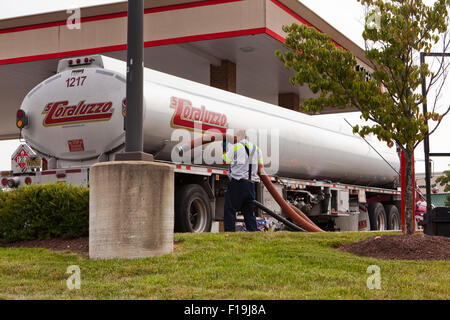 A fuel tank tractor trailer at gas station - Virginia USA - Stock Photo