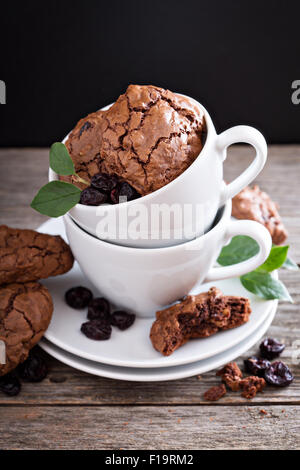 Chocolate walnut cherry cookies in coffee cups - Stock Photo