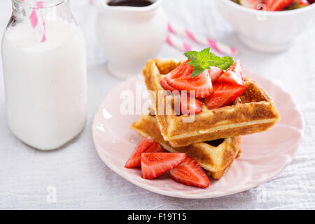 Waffles with maple syrup and berries Stock Photo, Royalty ...
