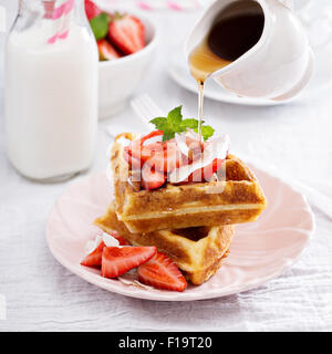 Ricotta waffles served with fresh strawberries and maple syrup - Stock Photo
