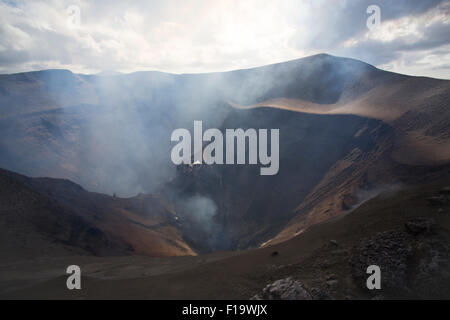 Melanesia, Vanuatu, Tanna Island, looking down into the crater of Mount Yasur Volcano. - Stock Photo