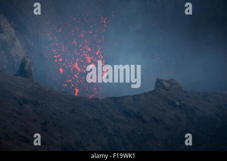 Melanesia, Vanuatu, Tanna Island, Mount Yasur Volcano, close up of hot lava. - Stock Photo