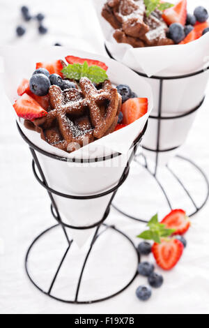 Small chocolate waffles with berries for dessert - Stock Photo