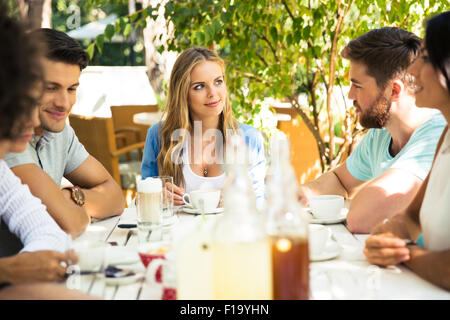 Group of a friends enjoying outdoor dinner party - Stock Photo