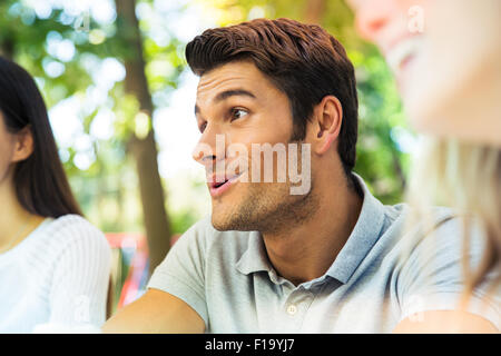 Portrait of a happy friends in outdoors restaurant - Stock Photo