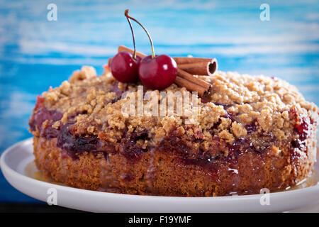 Cherry crumble coffee cake with cinnamonand streusel - Stock Photo