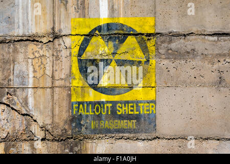 Fallout shelter sign at bunker entrance - Stock Photo