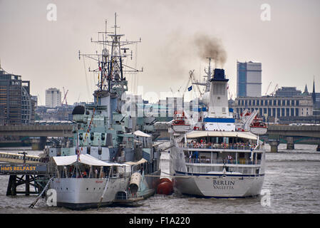HMS Belfast is a museum ship, originally a Royal Navy light cruiser, permanently moored in London on the River Thames - Stock Photo
