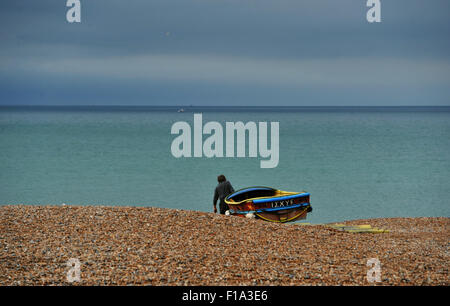 Brighton UK Monday 31st August 2015 - A fisherman heads out from Brighton beach early this August Bank Holiday Monday - Stock Photo