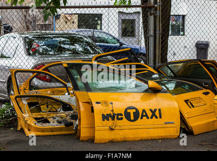 Scrapped yellow  New York Taxi Cab doors in Long Island City NY - Stock Photo