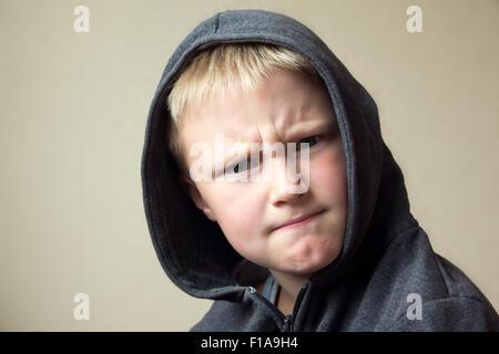 Angry child (boy, kid) portrait - Stock Photo