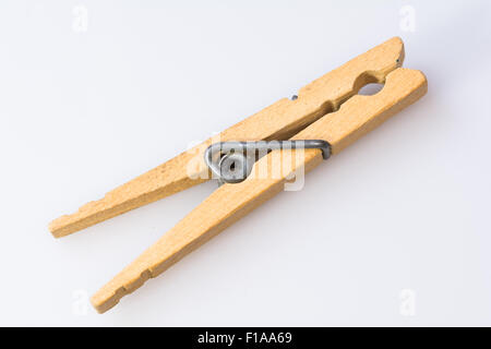 Old wooden clothes pin on white background - Stock Photo