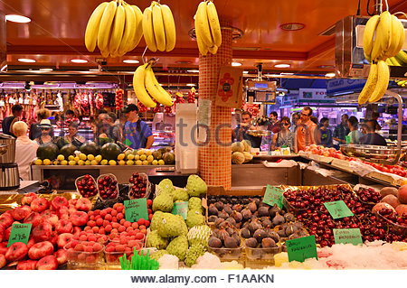 Fruits and vegetables stall at La Boqueria market in Ciutat Vella Barcelona Spain Europe - Stock Photo