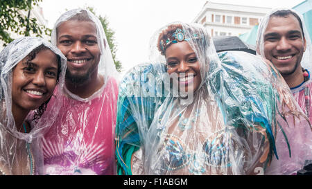 London, UK.  31 August 2015.  Dancers wearing rain ponchos at the start as heavy rain does not dampen the spirits - Stock Photo
