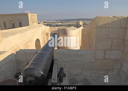 Old canon and view from the Citadel walls over Rabat (or Citta Victoria), Gozo, Malta.