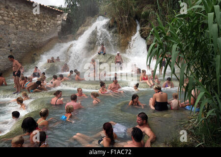 Manciano, Italy, bathers at the spa Cascate del Mulino in Saturnia - Stock Photo