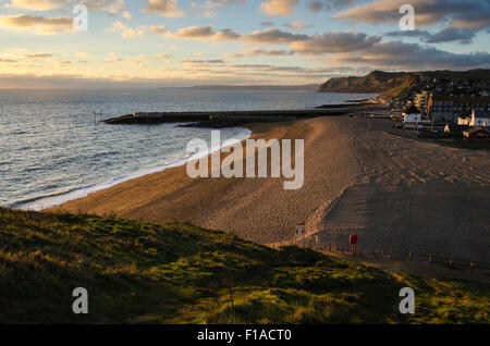 East Beach at West Bay in Dorset looking West from the slopes of East Cliff on the South West Coast path. - Stock Photo
