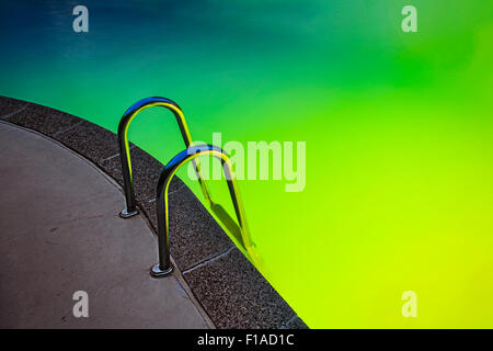 Swimming Pool At Night With Colorful Lights - Stock Photo