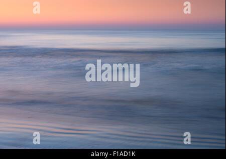 Ocean In Motion At Sunrise - Stock Photo