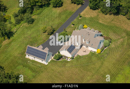 Aerial View Of House With Solar Panels - Stock Photo