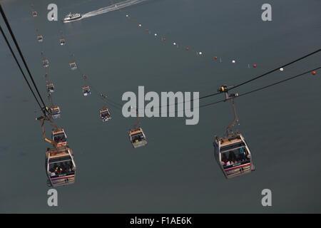 Hong Kong, China, gondolas of the cable car to Lantau Iceland over the South China Sea - Stock Photo