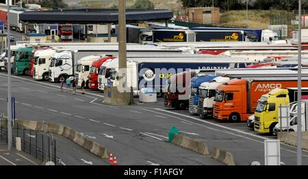 AJAXNETPHOTO. 22ND JULY, 2015. DUNKERQUE, FRANCE. - FREIGHT TRUCKS PARKED IN THE PORT WAITING TO BOARD A CROSS CHANNEL - Stock Photo