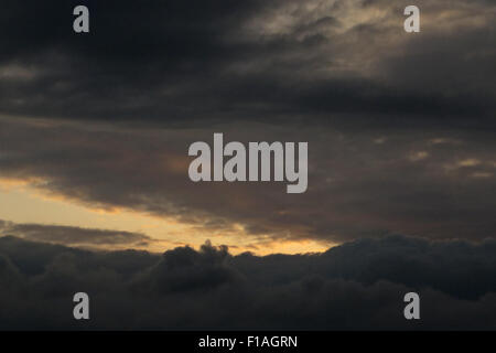 Berlin, Germany, cumulus cloud (front) and stratus clouds at dusk - Stock Photo