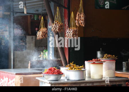 A roadside cafe with open wood fire selling fired fish and tea near Kathmandu on Highway H04 - Stock Photo
